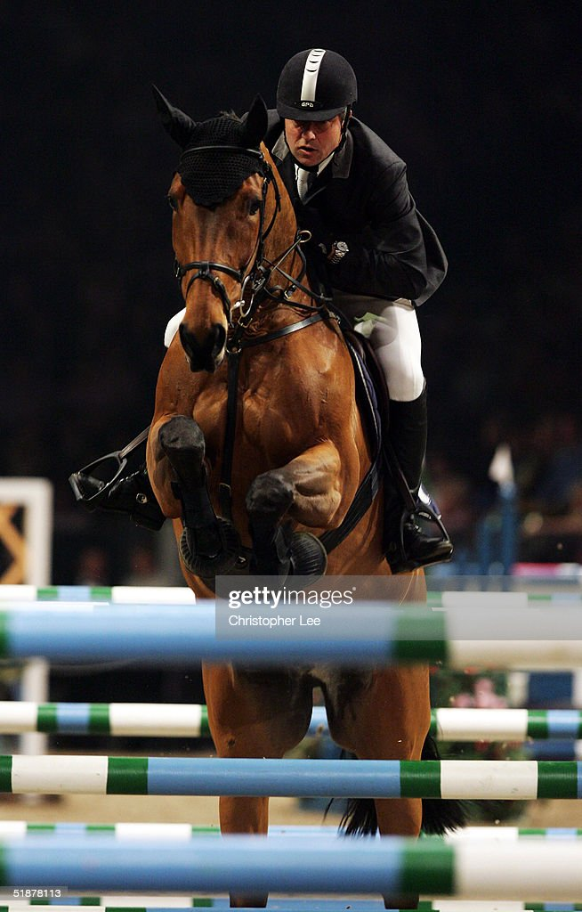 Philippe Leoni of France rides LB Oh Harry while in action