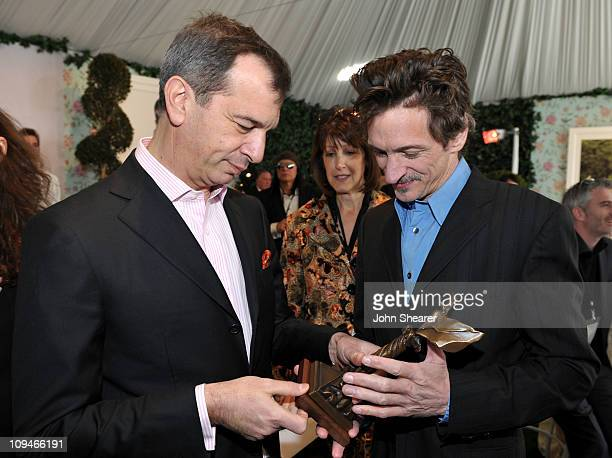 Philippe LeopoldMetzger Piaget CEO and John Hawkes winner of the Best Supporting Male award for 'Winter's Bone' in the Piaget Lounge at the 2011 Film...
