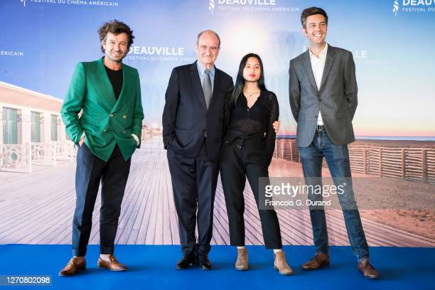 """Philippe Lezin, Pierre Lescure and his daughter Anna, and Maxime Switek attend the """"Pierre & Lescure"""" photocall at 46th Deauville American Film..."""