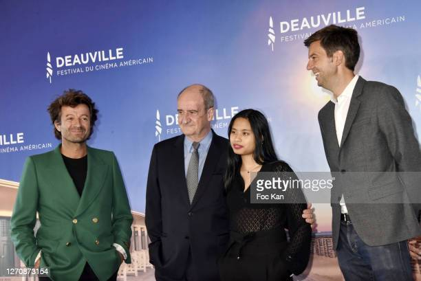 """Philippe Lezin, Pierre Lescure his daughter Anna, and Maxime Switek attend the """"Pierre & Lescure"""" photocall at 46th Deauville American Film Festival..."""