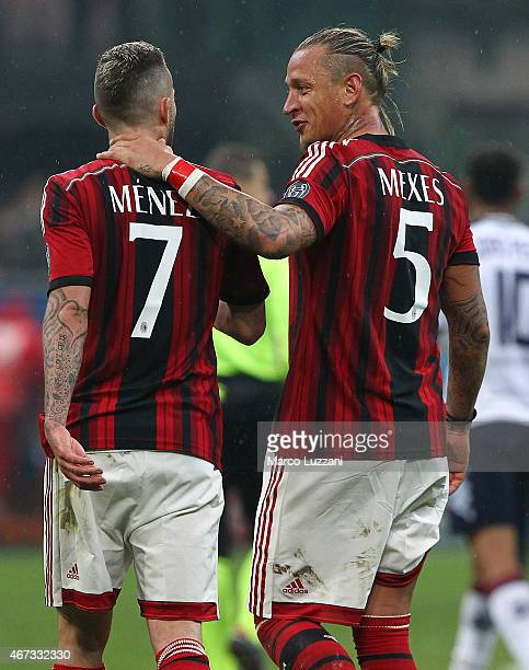 Philippe Mexes and Jeremy Menez of AC Milan celebrate a victory at the end of the Serie A match between AC Milan and Cagliari Calcio at Stadio...