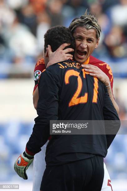 Philippe Mexes embraces Julio Sergio the goalkeeper of AS Roma during the Serie A match between Roma and Bari at Stadio Olimpico on November 22 2009...