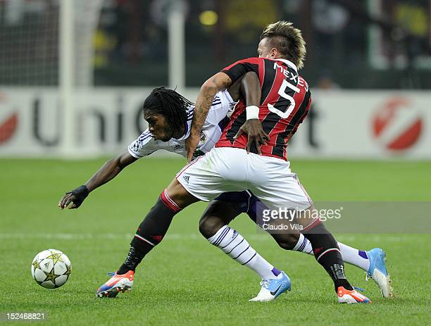 Philippe Mexes of AC Milan and Dieudonne Mbokani of RSC Anderlecht compete for the ball during the UEFA Champions League group C match between AC...
