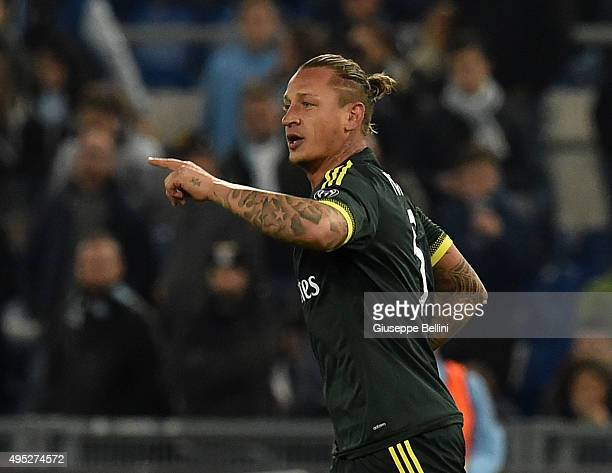 Philippe Mexes of AC Milan celebrates after scoring the goal 02 during the Serie A match between SS Lazio and AC Milan at Stadio Olimpico on November...