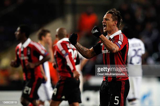 Philippe Mexes of AC Milan celebrates scoring a goal during the UEFA Champions League Group C match between RSC Anderlecht and AC Milan at the...