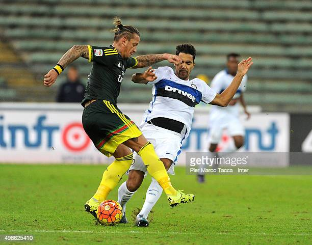 Philippe Mexes of AC Milan competes for the ball with Pedro Delgado of FC Internazionale during a pre season tournament between FC Internazionale AC...