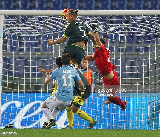 Philippe Mexes of AC Milan scores the team's second goal during the Serie A match between SS Lazio and AC Milan at Stadio Olimpico on November 1 2015...