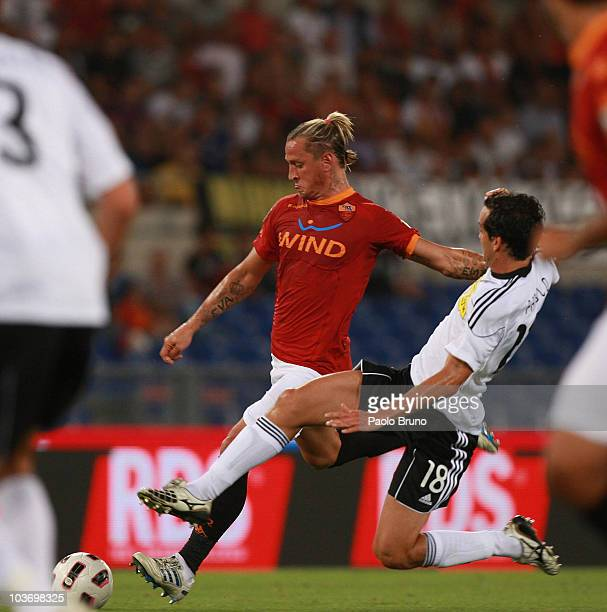 Philippe Mexes of AS Roma and Marco Parolo of AC Cesena in action during the Serie A match between AS Roma and AC Cesena at Stadio Olimpico on August...