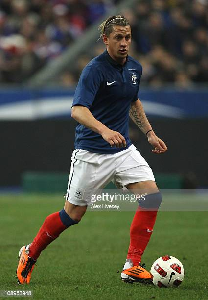 Philippe Mexes of France runs with the ball during the International friendly match between France and Brazil at Stade de France on February 9 2011...