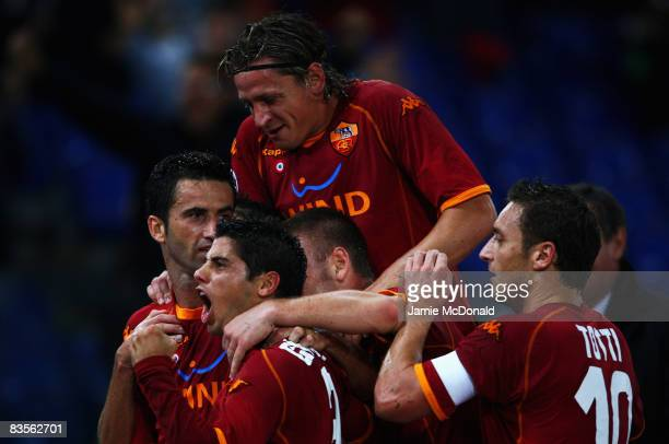 Philippe Mexes of Roma celebrates Christian Panucci's opening goal during the UEFA Champions League Group A match between AS Roma and Chelsea at the...