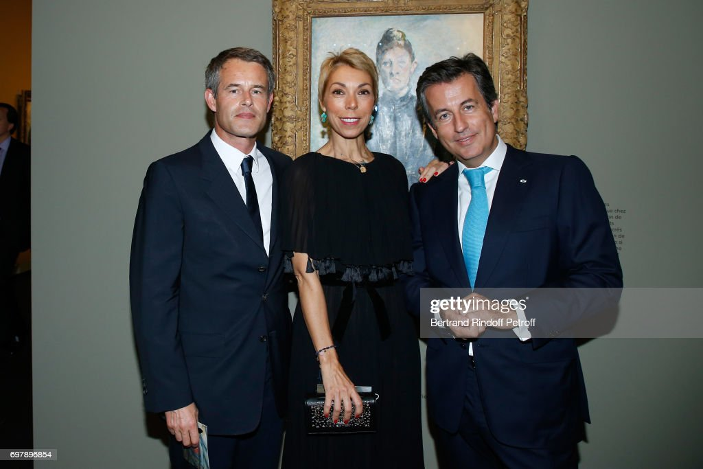 Philippe Mugnier, Mathilde Favier and Cyril Karaoglan attend the 'Societe ses Amis du Musee d'Orsay' : Dinner Party at Musee d'Orsay on June 19, 2017 in Paris, France.