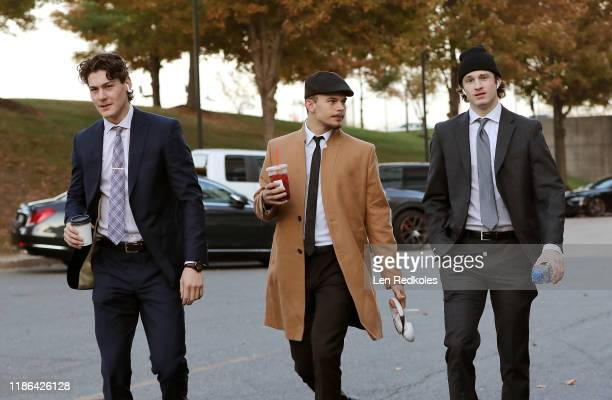 Philippe Myers, Carsen Twarynski, and Joel Farabee of the Philadelphia Flyers walk through the parking lot while entering the arena for their evening...