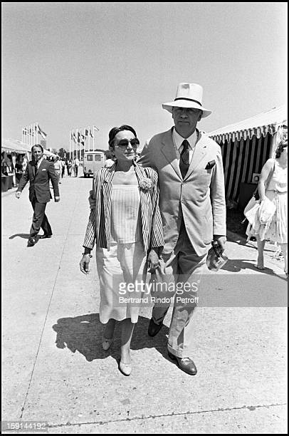 Philippe Noiret and his wife Monique Chaumette attend a horse jumping competition in 1981