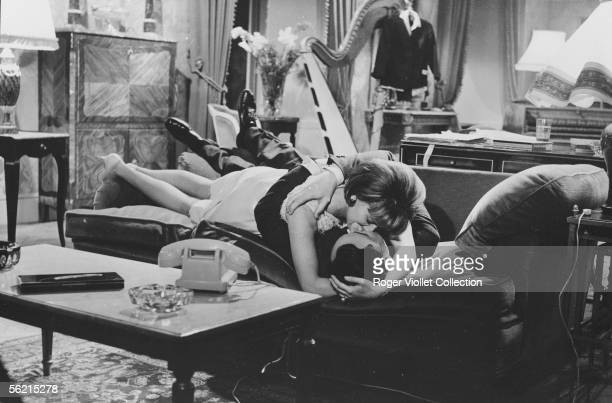 Philippe Noiret and Liselotte Pulver in the film of JeanPaul Le Chanois 'Monsieur' France Italy Germany 1964