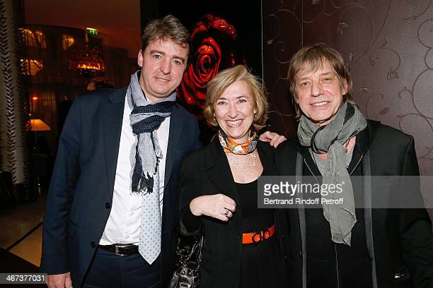 Philippe Perrot Laure Du Manoir and Arthur Aubert attend Arthur Aubert Exhibition private view Held at Le Fouquet's Barriere Hotel on February 6 2014...