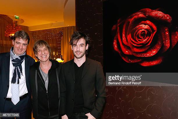 Philippe Perrot Singer JeanLouis Aubert and his son Arthur Aubert attend the Arthur Aubert Exhibition private view Held at Le Fouquet's Barriere...