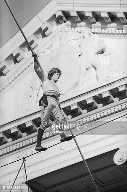 Philippe Petit celebrated French high wire artist walks the high wire connecting the north and south wings of the Museum of the City of New York...