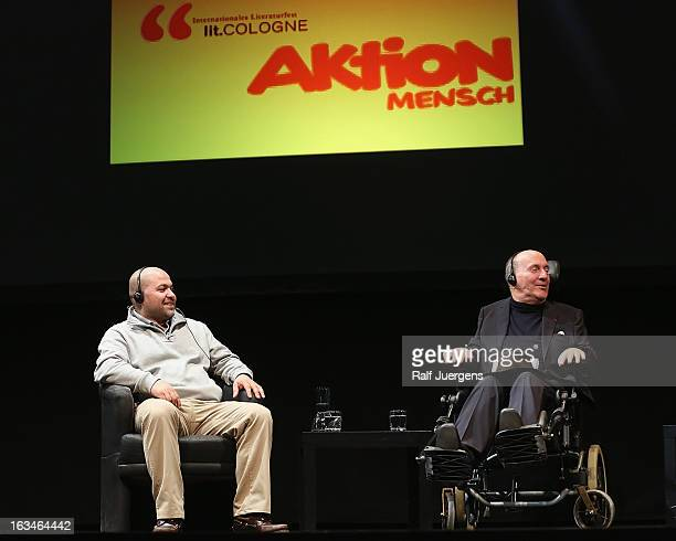 Philippe Pozzo di Borgo and Abdel Sellou talk about their books 'Ziemlich beste Freunde' and 'Einfach Freunde' during the lit Cologne at 'Oper am...