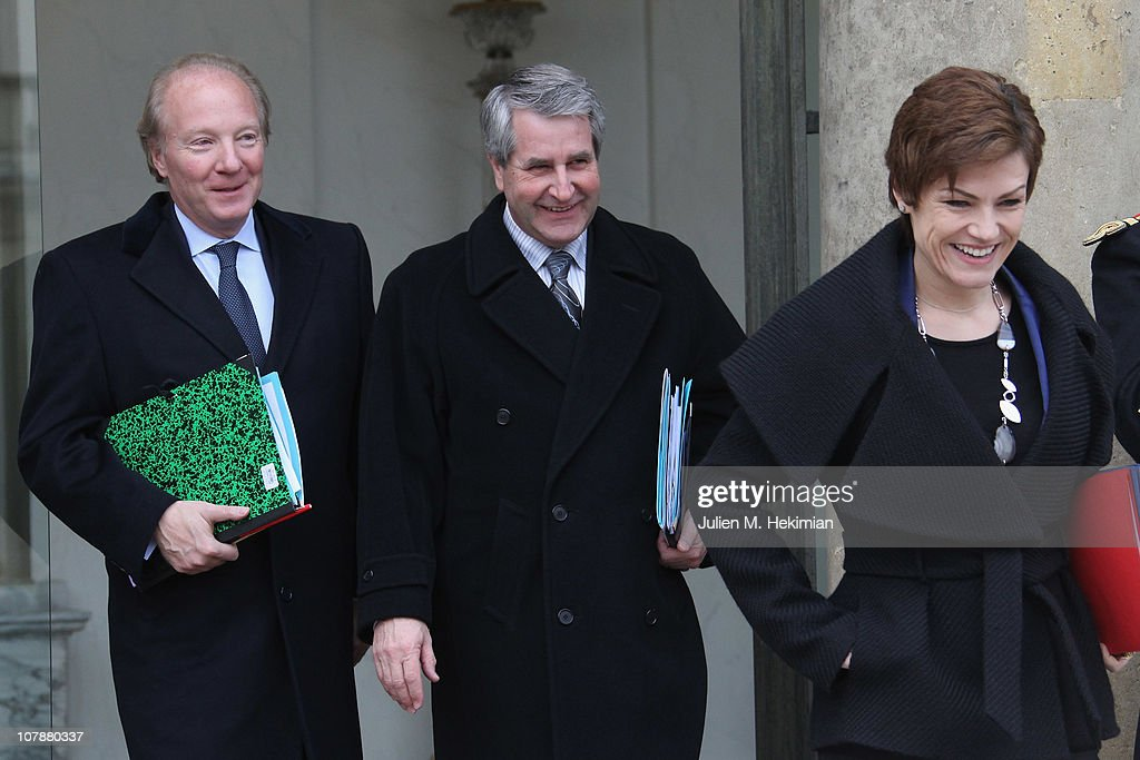 Philippe Richert , Minister for the Minister of the Interior, Overseas, Local Authorities and Immigration, with responsibility for Local Authorities (C), Brice Hortefeux, Minister of the Interior, Overseas, Local Authorities and Immigration (L) and Minister for Sport Chantal Jouanno leave the first weekly cabinet meeting of the new year on January 5, 2011 in Paris, France.