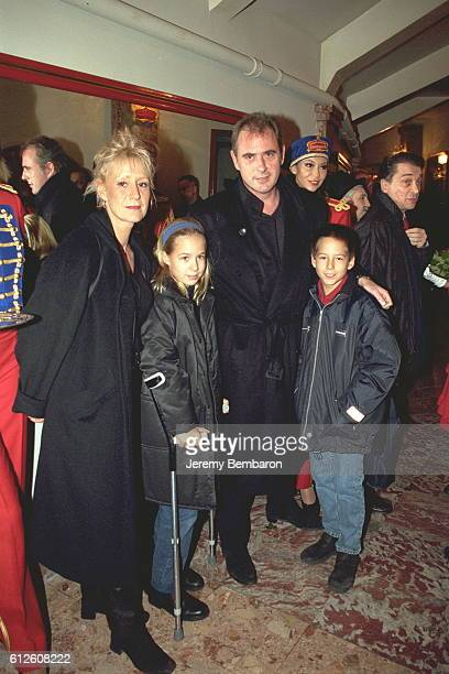 Philippe Risoli with his wife and their twin sons