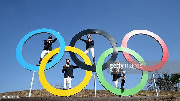 Philippe Rozier, Kevin Bost, Penelope Leprevost and Roger-Yves Bost of France celebrate after winning the gold medal during the show jumping team...