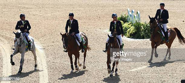 Philippe Rozier, Kevin Staut, Penelope Leprovost and Roger-Yves Bost of France celebrate after winning the gold medal during the show jumping team...