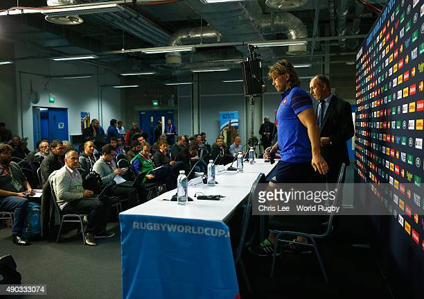 Philippe SaintAndre and Dimitri Szarzewski of France arrive for the press conference during the 2015 Rugby World Cup Pool D match between France and...