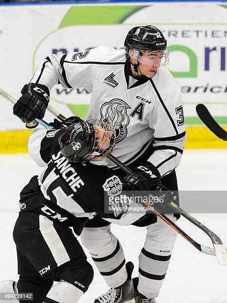 Philippe Sanche of the BlainvilleBoisbriand Armada skates into Yakov Trenin of the Gatineau Olympiques during the QMJHL game at the Centre...