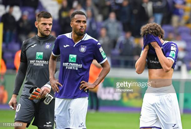 Philippe Sandler defender of Anderlecht and Isaac Kiese Thelin forward of Anderlecht with Hendrik Van Crombrugge Goalkeeper of Anderlecht looks...