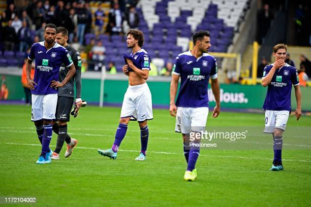 Philippe Sandler defender of Anderlecht and teammates looks dejected after missing a opportunity to to win the match pictured during the Jupiler Pro...