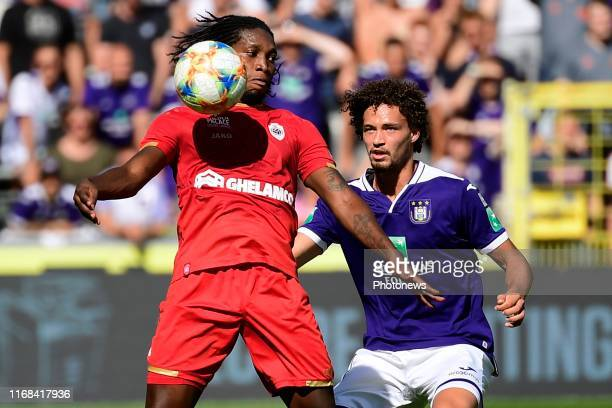 Philippe Sandler defender of Anderlecht battles for the ball with Dieudonne Mbokani Bezua forward of Antwerp during the Jupiler Pro League match...