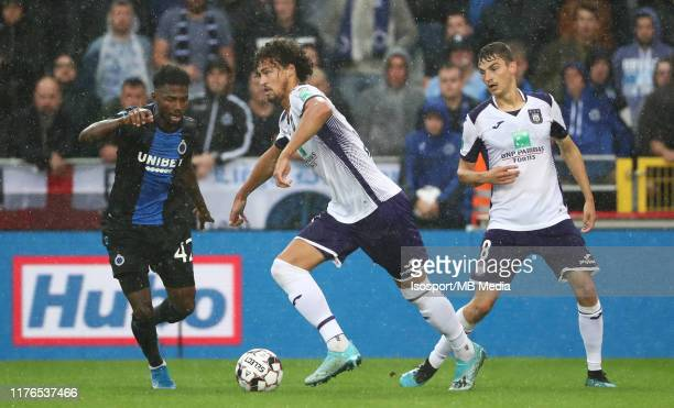 Philippe Sandler of Anderlecht battles for the ball with Emmanuel Bonaventure Dennis of Club Brugge during the Jupiler Pro League match between Club...