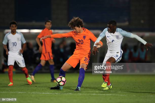 Philippe Sandler of Netherlands and Stephy Mavididi of England in a challenge for the ball during the international match between England U20 v...