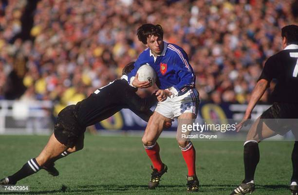 Philippe Sella of France is tackled during the Rugby World Cup Final against New Zealand at Eden Park Auckland New Zealand 20th June 1987 New Zealand...