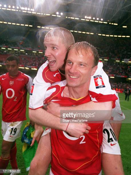 Philippe Senderos and Dennis Bergkamp of Arsenal celebrate after the FA Cup Final match between Arsenal and Manchester United on May 21 2005 in...