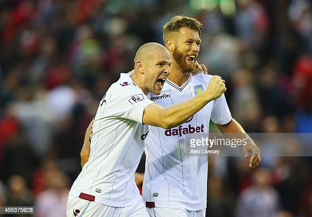 Philippe Senderos of Aston Villa celebrates victory with Nathan Baker after the Barclays Premier League match between Liverpool and Aston Villa at...