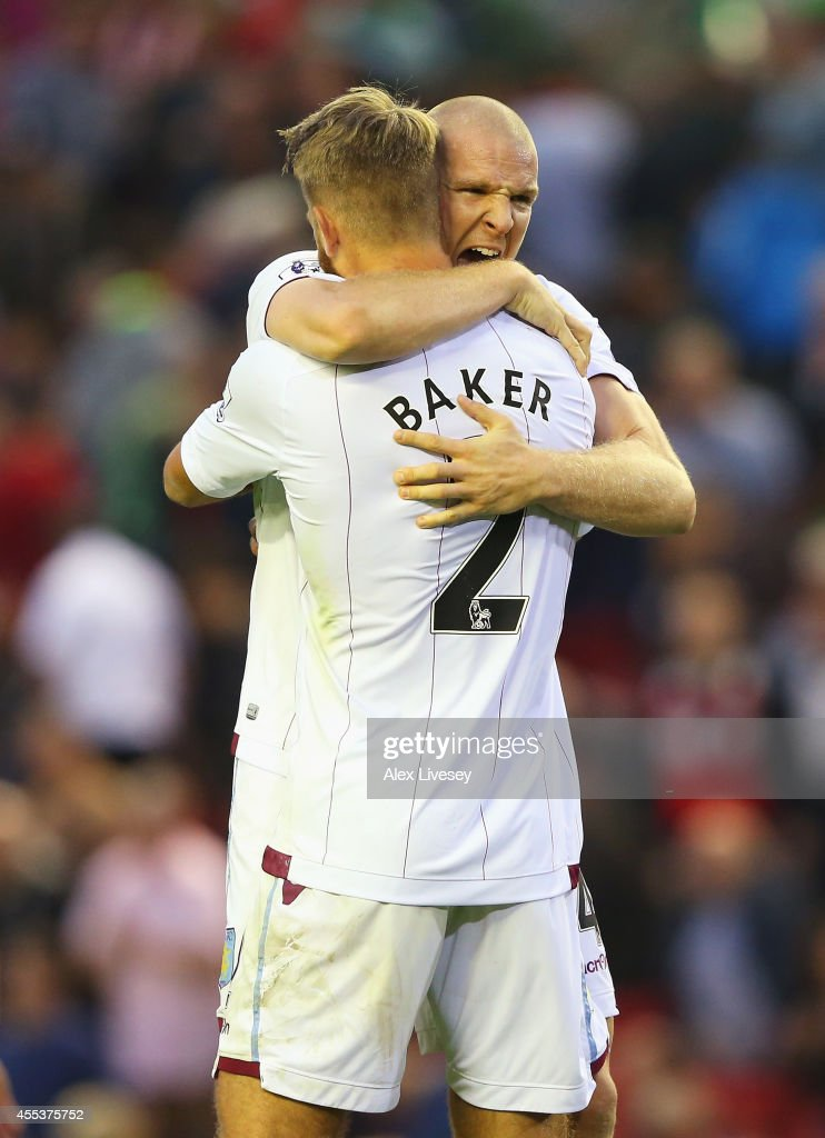 Philippe Senderos of Aston Villa celebrates victory with Nathan Baker after the Barclays Premier League match between Liverpool and Aston Villa at Anfield on September 13, 2014 in Liverpool, England.