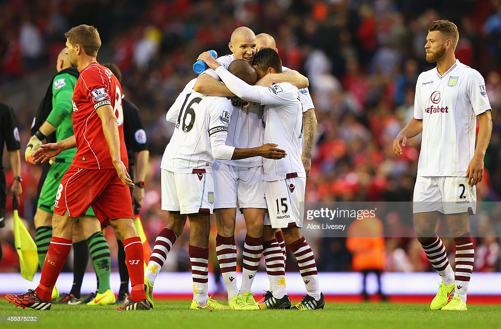 Philippe Senderos of Aston Villa celebrates victory with team mates after the Barclays Premier League match between Liverpool and Aston Villa at Anfield on September 13, 2014 in Liverpool, England.