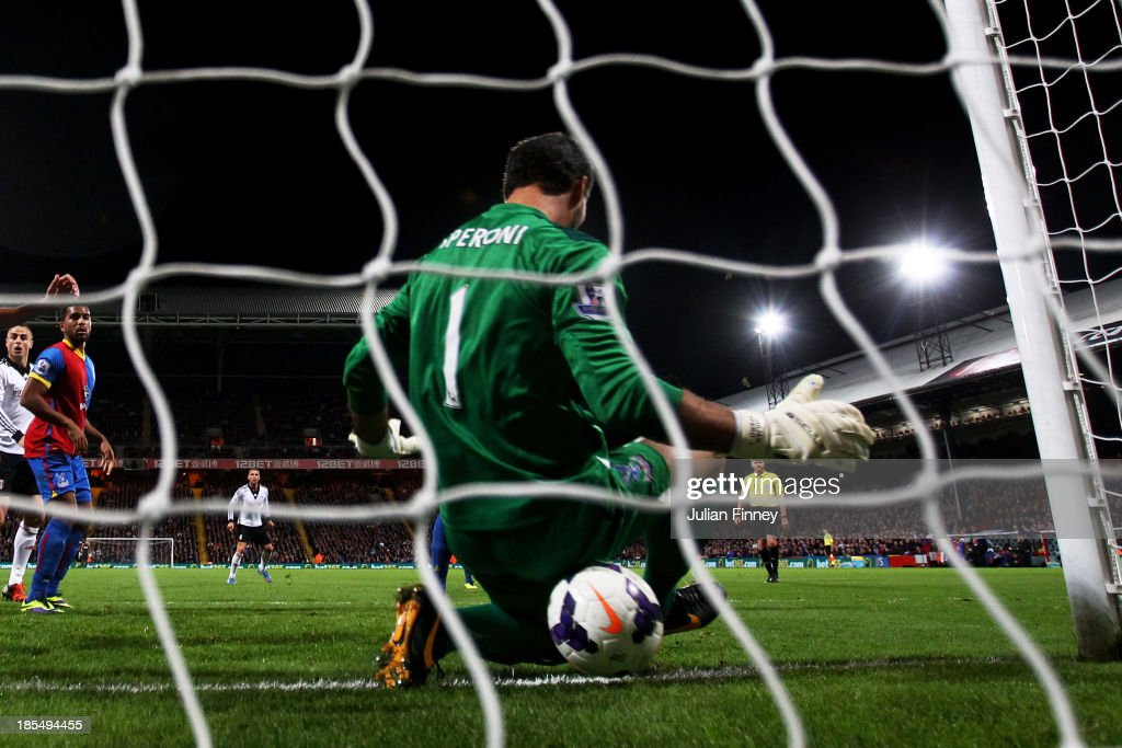 Philippe Senderos (not Shown) of Fulham squeezes the ball through the legs of goalkeeper Julian Speroni of Crystal Palace to score his team's fourth goal during the Barclays Premier League match between Crystal Palace and Fulham at Selhurst Park on October 21, 2013 in London, England.