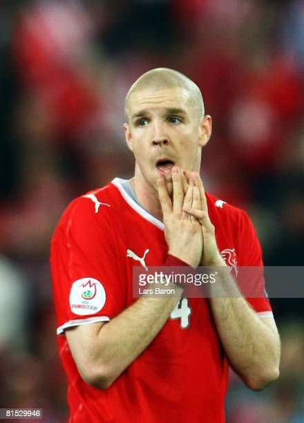Philippe Senderos of Switzerland looks dejected after losing the UEFA EURO 2008 Group A match between Switzerland and Turkey at St JakobPark on June...