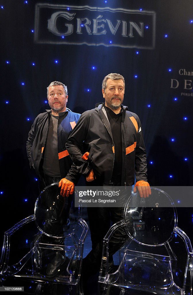 Philippe Starck (L) poses next to his wax figure at Musee Grevin on June 15, 2010 in Paris, France.