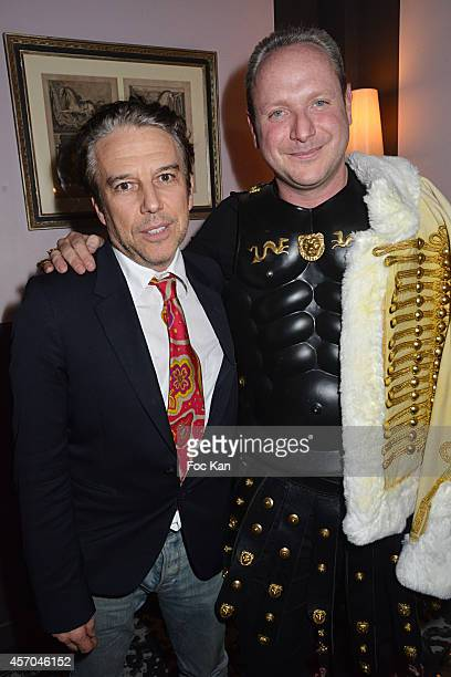 Philippe Vandel and Gregory Dorcel attend the Marc Dorcel 35th Anniversary Masked Ball at the Chalet des Iles on October 10 2014 in Paris France