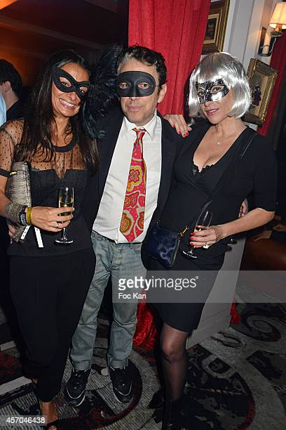 Philippe Vandel and two girl friends attend the Marc Dorcel 35th Anniversary Masked Ball at the Chalet des Iles on October 10 2014 in Paris France