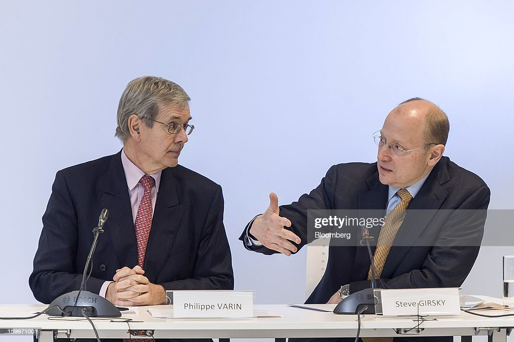 Philippe Varin, chief executive officer of PSA Peugeot Citroen, left, listens as Stephen 'Steve' Girsky, vice chairman of General Motors Co., speaks during a joint news conference in Brussels, Belgium, on Thursday, Jan. 24, 2013. General Motors Co. and PSA Peugeot Citroen said the French carmaker will take the lead in developing joint models as the first anniversary approaches of an alliance aimed at restoring profit to European operations. Photographer: Jock Fistick/Bloomberg via Getty Images