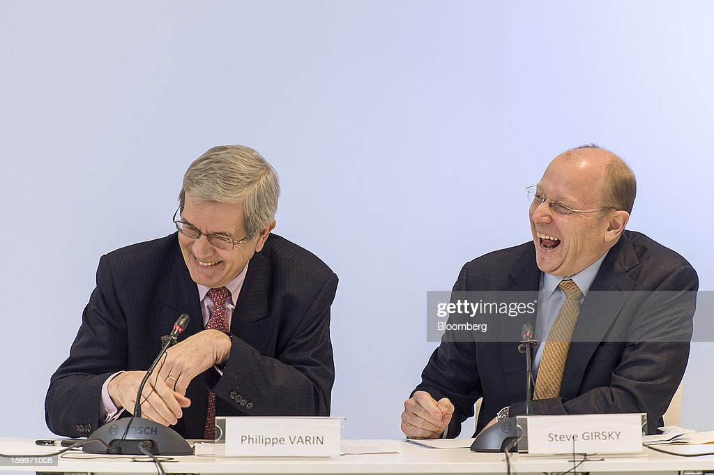 Philippe Varin, chief executive officer of PSA Peugeot Citroen, left, and Stephen 'Steve' Girsky, vice chairman of General Motors Co., react during a joint news conference in Brussels, Belgium, on Thursday, Jan. 24, 2013. General Motors Co. and PSA Peugeot Citroen said the French carmaker will take the lead in developing joint models as the first anniversary approaches of an alliance aimed at restoring profit to European operations. Photographer: Jock Fistick/Bloomberg via Getty Images