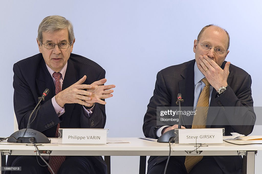 Philippe Varin, chief executive officer of PSA Peugeot Citroen, left, gestures as Stephen 'Steve' Girsky, vice chairman of General Motors Co., looks on during a joint news conference in Brussels, Belgium, on Thursday, Jan. 24, 2013. General Motors Co. and PSA Peugeot Citroen said the French carmaker will take the lead in developing joint models as the first anniversary approaches of an alliance aimed at restoring profit to European operations. Photographer: Jock Fistick/Bloomberg via Getty Images