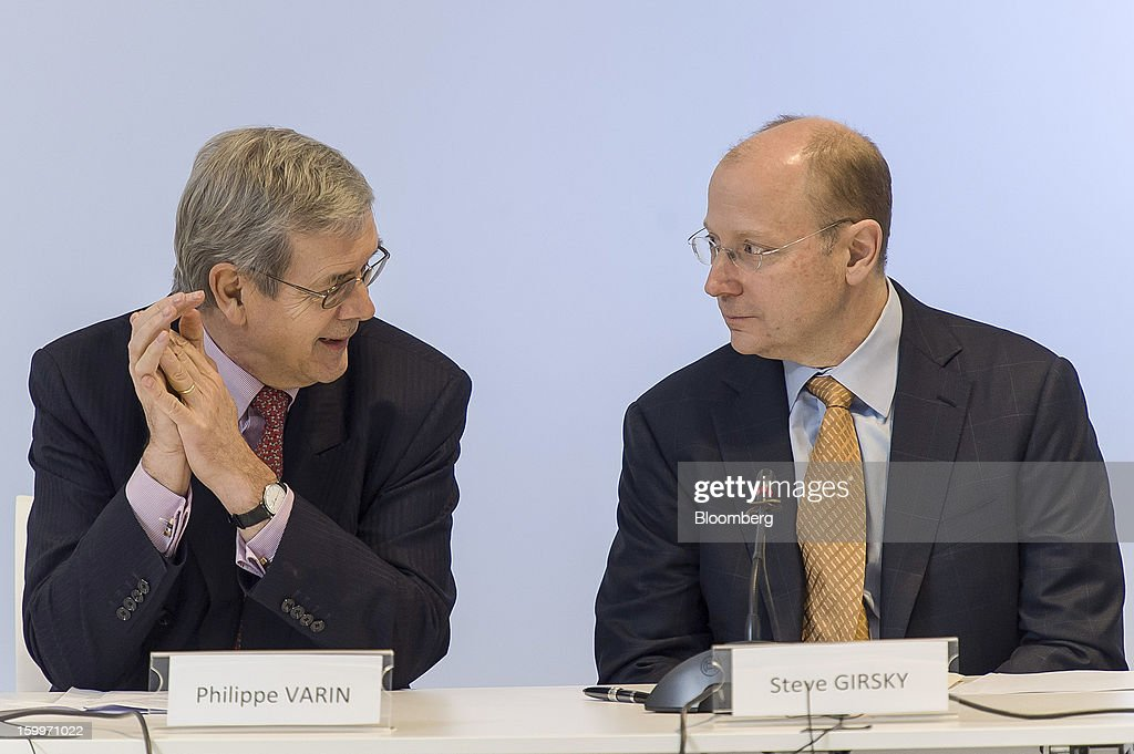 Philippe Varin, chief executive officer of PSA Peugeot Citroen, left, speaks to Stephen 'Steve' Girsky, vice chairman of General Motors Co., during a joint news conference in Brussels, Belgium, on Thursday, Jan. 24, 2013. General Motors Co. and PSA Peugeot Citroen said the French carmaker will take the lead in developing joint models as the first anniversary approaches of an alliance aimed at restoring profit to European operations. Photographer: Jock Fistick/Bloomberg via Getty Images