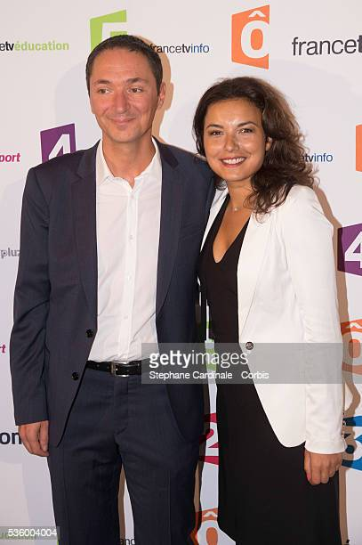 Philippe Verdier and Anais Baydemir attend 'France Televisions' Photocall at Palais De Tokyo on August 26 2014 in Paris France