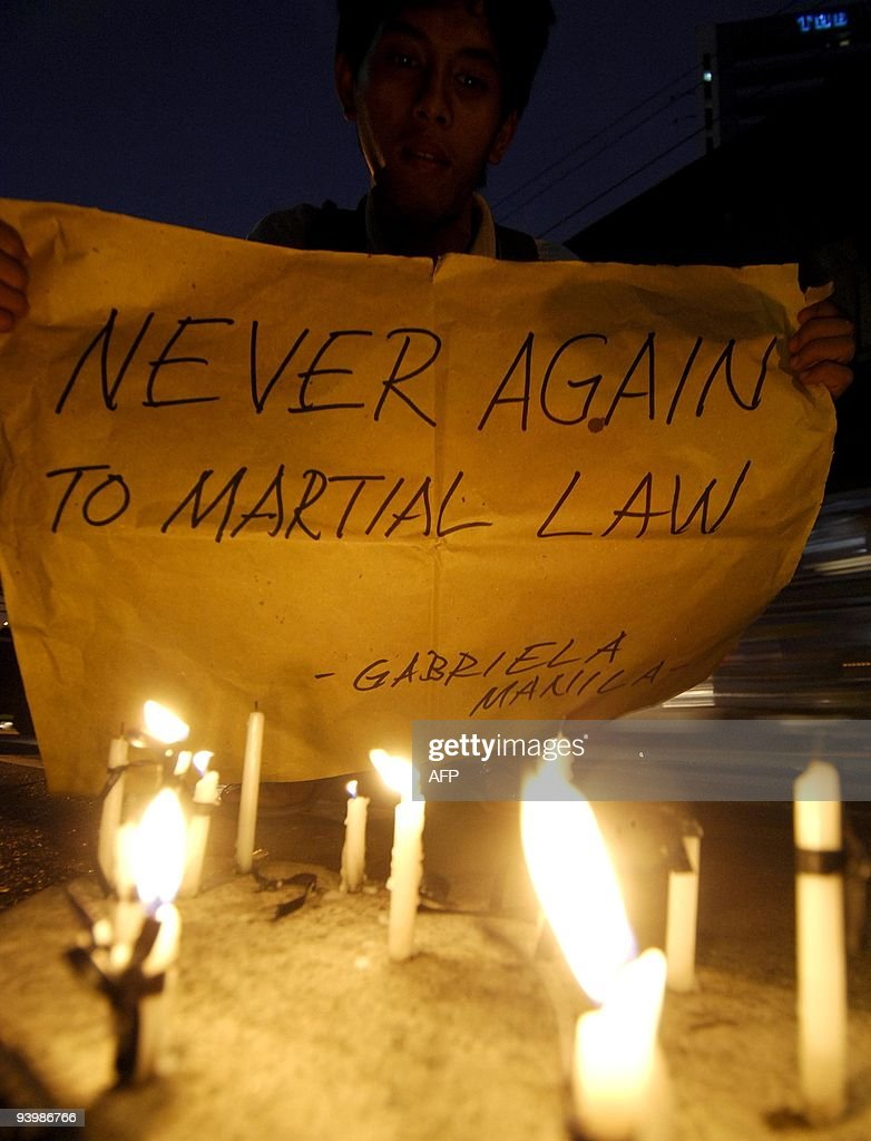 A Philippine activist holds a banner at : News Photo