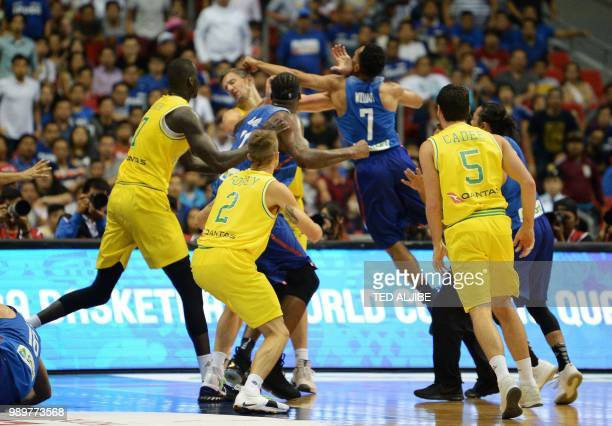 TOPSHOT Philippine and Australian players engage in a brawl during their FIBA World Cup Asian qualifier game at the Philippine arena in Bocaue town...